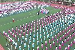 November 10, 2018 - Lianyungang, Lianyungang, China - Lianyungang,CHINA-More than one thousand and two hundred pupils recite traditional Chinese poems at a primary school in Guanyun County, Lianyungang, east China's Jiangsu Province. (Credit Image: © SIPA Asia via ZUMA Wire)