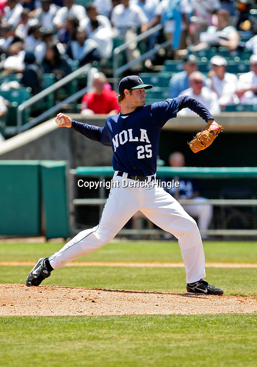2009 April 20: New Orleans Zephyrs pitcher, Brett Sinkbeil (25) throws during a AAA Minor League Baseball game between the New Orleans Zephyrs AAA affiliate for the Florida Marlins and the Nashville Sounds a AAA affiliate for the Milwaukee Brewers at Zephyrs Stadium in Metairie, Louisiana.