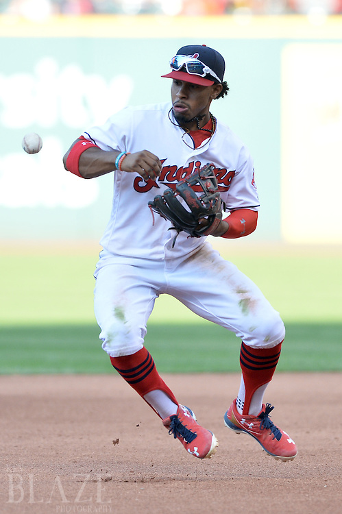 Sep 4, 2016; Cleveland, OH, USA; Cleveland Indians shortstop Francisco Lindor (12) bobbles a ball hit by Miami Marlins shortstop Miguel Rojas (not pictured) during the seventh inning at Progressive Field. Mandatory Credit: Ken Blaze-USA TODAY Sports