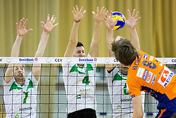 Ivan Colovic, Uros Pavlovic and Dejan Pelemis of Panvita vs Jan Klobucar of ACH  during volleyball game between OK ACH Volley and OK Panvita Pomgrad in 1st final match of Slovenian National Championship 2013/14, on April 6, 2014 in Arena Tivoli, Ljubljana, Slovenia. Photo by Vid Ponikvar / Sportida