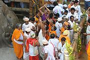 Jain devotees at the foot of gomateshvara bahubali statue, Shravanbelagola, Hassan, Karnataka, India during the Mahamastakabhisheka festival - The anointment of the Bahubali Gommateshwara Statue. This is an important Jain festival held once in every 12 years. (February 2018)