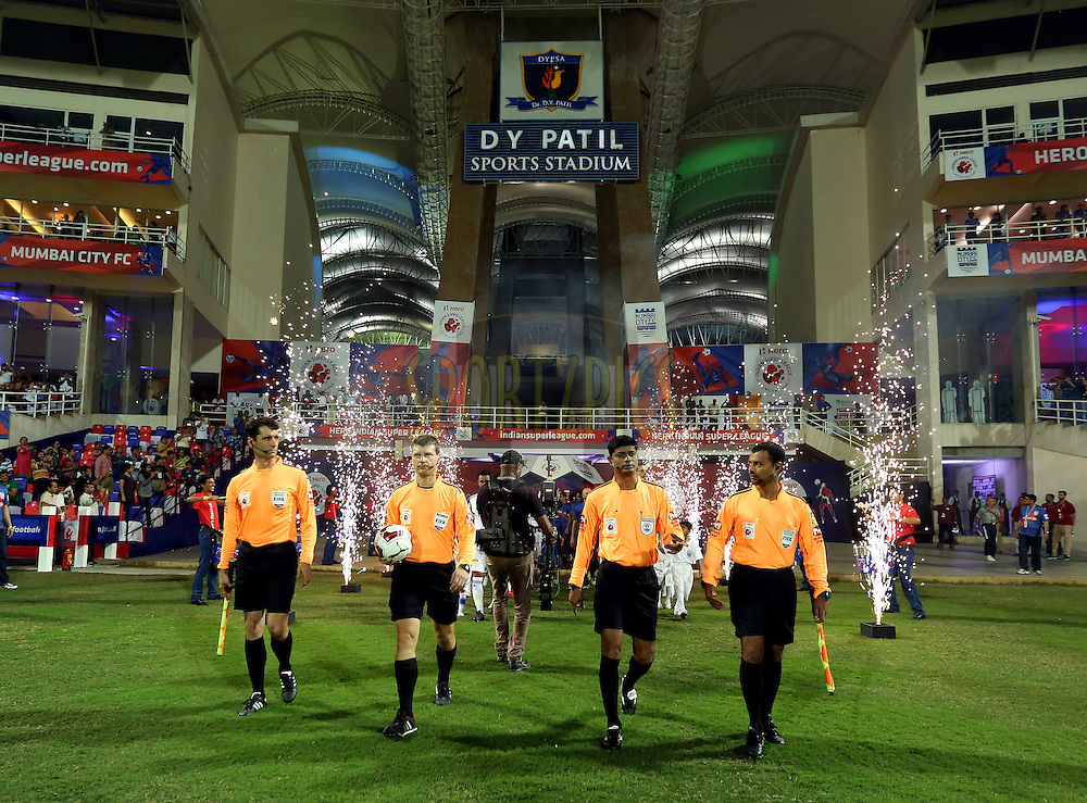 Team walks in before the match 11 of the Hero Indian Super League between Mumbai City FC and North East United FC City held at the D.Y. Patil Stadium, Navi Mumbai, India on the 24th October 2014.<br /> <br /> Photo by:  Sandeep Shetty/ ISL/ SPORTZPICS