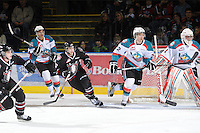 KELOWNA, CANADA - FEBRUARY 18: Madison Bowey #4 and Mackenzie Johnston #22 of the Kelowna Rockets and Chad Robinson #17 of the Red Deer Rebels skate on the ice as the Red Deer Rebels visit the Kelowna Rockets on February 18, 2012 at Prospera Place in Kelowna, British Columbia, Canada (Photo by Marissa Baecker/Shoot the Breeze) *** Local Caption ***