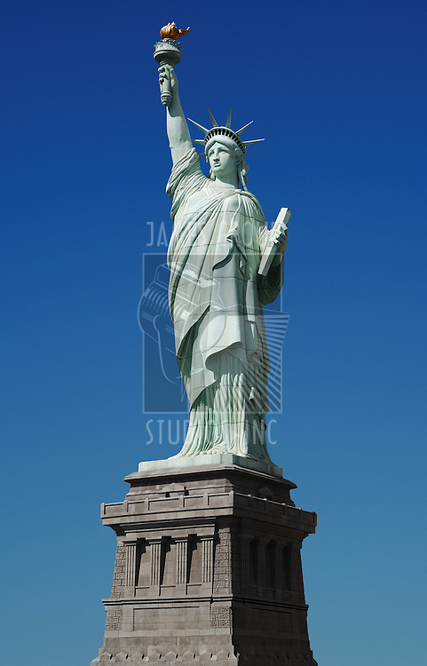 Statue of Liberty against blue sky with clipping path