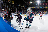 KELOWNA, CANADA - FEBRUARY 14: Conner Bruggen-Cate #20 and Jack Cowell #8 of the Kelowna Rockets dig for the puck at the boards while checked by Grayson Pawlenchuk #16 of the Red Deer Rebels on February 14, 2018 at Prospera Place in Kelowna, British Columbia, Canada.  (Photo by Marissa Baecker/Shoot the Breeze)  *** Local Caption ***