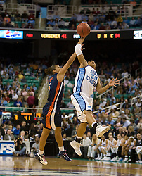 North Carolina guard Italee Lucas (50) intercepts a pass intended for Virginia guard Sharnee Zoll (5).  The #4 seed/#25 ranked Virginia Cavaliers women's basketball team fell to the #1 seed/#2 ranked North Carolina Tar Heels 80-65 in the semifinals of the 2008 ACC Women's Basketball Tournament at the Greensboro Coliseum in Greensboro, NC on March 8, 2008.