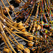Multiple berimbau, a musical instrument, for sale in a street market, Salvador, Brazil. Photo by Jen Klewitz