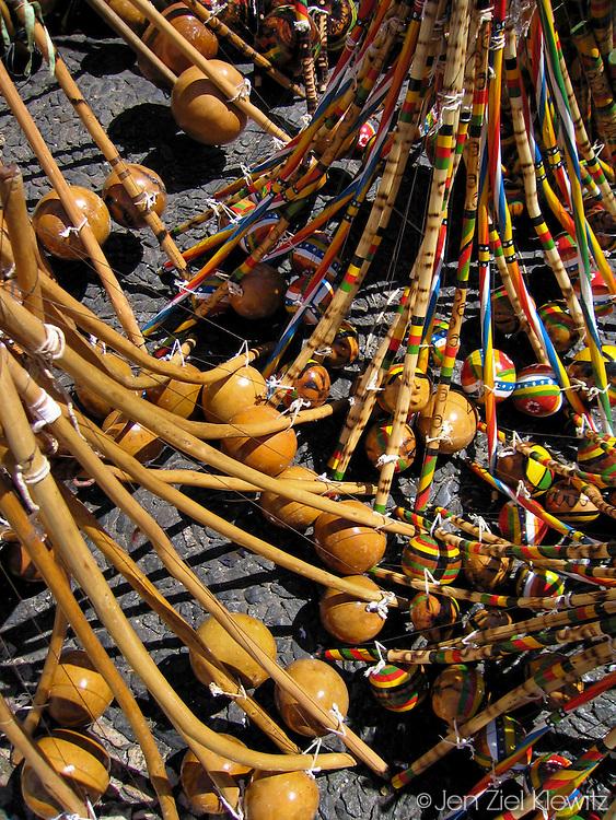 Multiple berimbau, a musical instrument, for sale in a street market, Salvador, Brazil. Photo by Jen Klewitz