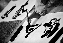 Chinese disabled artist Xi Fu writes Chinese calligraphy with his feet in an underground pass in the shopping district of Xidan in Beijing, China 15 June 2013. Few people can master the art of Chinese calligraphy with good functioning hands, much less with their feet. Chinese disabled artist Xi Fu however, made it look like a piece of cake. The 34-year-old whose name meant 'Treasure Happiness' is a common sight in the underground passes of the bustling shopping district of Xidan or tourist walkways of Houhai in Beijing. Passers-by are mesmerize by his skillful display of calligraphic art using only his feet. Xi Fu's story is one that tells of how strong determination and hard work overcame the difficulties of surviving in a society scant with infrastructure and support for the disabled and where they are often discriminated and sidelined.