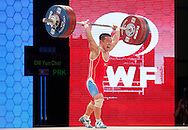Nov 21, 2015; Houston, TX, USA;  Yun Chol Om, from South Korea sets the World Record in the men's 56kg clean and jerk  International Weightlifting Federation World Championships with a lift of 171 kg at George R. Brown Convention Center. Mandatory Credit: Thomas B. Shea-USA TODAY Sports