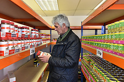© Licensed to London News Pictures. 02/02/2016. London, UK. A shopper at The new easyFoodstore budget Supermarket in Park Royal, north London which is selling a range of food products all at 25p each. The discount shop, which is owned by the EasyJet company, offers shoppers groceries ranging from pasta to beans to cleaning products. Fresh meat, fruit and vegetables are not yet available. Photo credit: Ray Tang/LNP