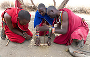Maasais making fire. From Amboseli, Kenya.