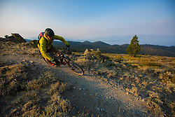 A wildfire inspired sunrise on The Bench, part of the Tahoe Rim Trail .<br /> <br /> Rider - Jeremy Benson