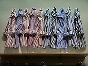 striped shirts hanging on a wall in a department store
