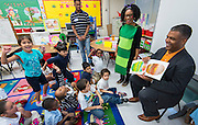 Staff and students participate in a presentation of the Wizard of Oz during International Literacy Day activities at Anderson Elementary School, September 8, 2014.