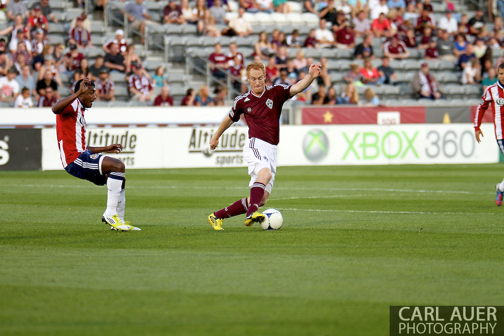 August 18th, 2012: Colorado Rapids midfielder Jeff Larentowicz (4) keeps the ball away from the Chivas USA defense in the first half at Dick's Sporting Goods Park