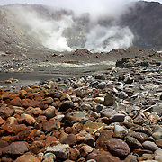 Whakaari or White Island is an active volcano, situated 48 km from the east coast of the North Island of New Zealand, in the Bay of Plenty. .The island is roughly circular, about 2 km in diameter, and rises to a height of 321 m  above sea level. Sulphur mining was attempted but was abandoned in 1914 after ten workers were killed. It is New Zealand's only active marine volcano and perhaps the most accessible on earth, attracting scientists and volcanologists worldwide as well as many tourists. It is part of the Taupo Volcanic Zone.. The main activities on the island now are guided tours and scientific research. White Island, New Zealand,. 5th December 2010.  Photo Tim Clayton.