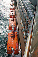 Celebrity Eclipse interior photos..Lifeboats suspended from the side of the ship.
