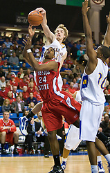 February 27, 2010; San Jose, CA, USA;  San Jose State Spartans guard Justin Graham (5) blocks a shot from Fresno State Bulldogs guard/forward Paul George (24) during the second half at The Event Center.  San Jose State defeated Fresno State 72-45.