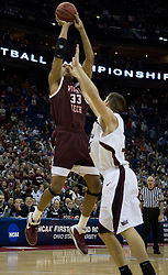 Virginia Tech Hokies forward Coleman Collins (33) shoots over Southern Illinois Salukis forward Tony Boyle (35).  The #4 seed Southern Illinois Salukis defeated the #5 seed Virginia Tech Hokies 63-48 in the second round of the Men's NCAA Basketball Tournament at the Nationwide Arena in Columbus, OH on March 18, 2007.