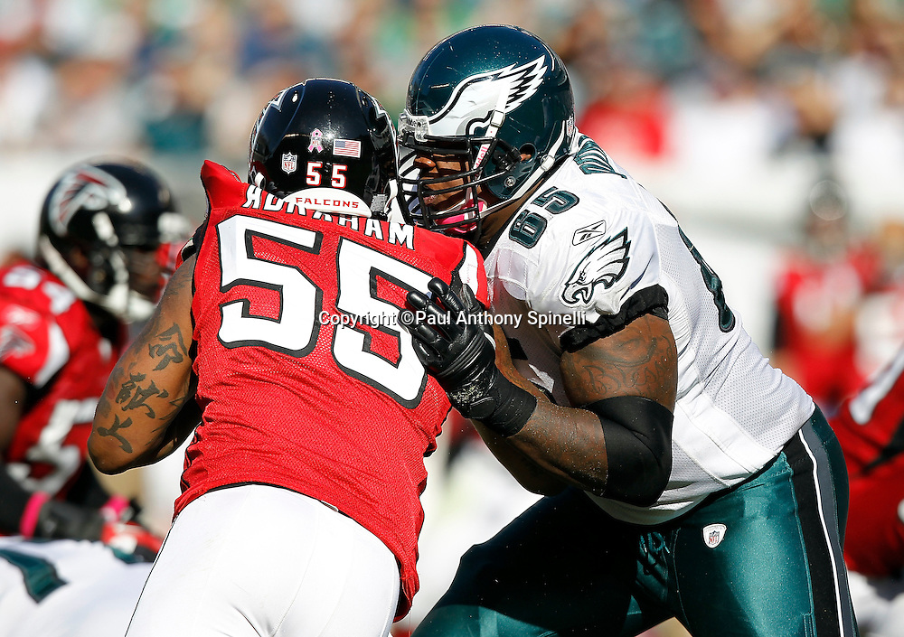 Atlanta Falcons defensive end John Abraham (55) gets blocked by Philadelphia Eagles offensive tackle King Dunlap (65) during the NFL week 6 football game against the Philadelphia Eagles on Sunday, October 17, 2010 in Philadelphia, Pennsylvania. The Eagles won the game 31-17. (©Paul Anthony Spinelli)