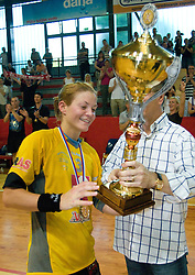 Spela Cerar accpeting the Cup from the president of RZS Franjo Bobinac at the Final handball game of the Slovenian Women handball Championship between RK Krim Mercator and RK Olimpija when Krim Mercator won the Championship and became Slovenian National Champion, on May 23, 2009, Kodeljevo, Ljubljana, Slovenia.  (Photo by Klemen Kek / Sportida)