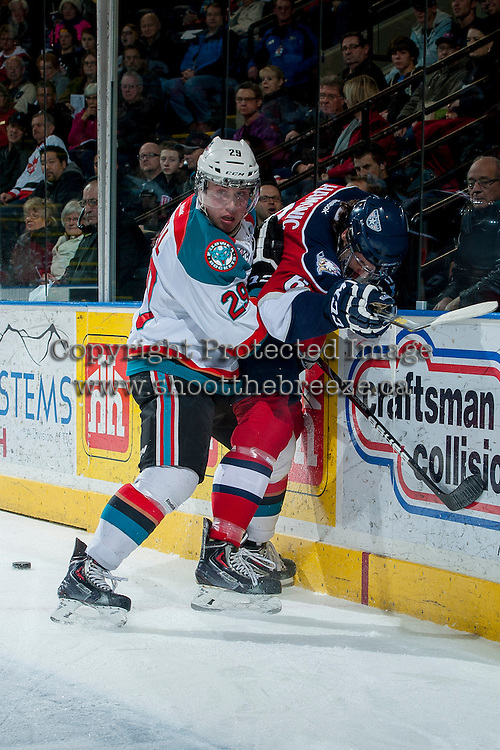 KELOWNA, CANADA -FEBRUARY 19: Myles Bell #29 of the Kelowna Rockets checks Justin Hamonic #6 of the Tri City Americans into the boards during first period on February 19, 2014 at Prospera Place in Kelowna, British Columbia, Canada.   (Photo by Marissa Baecker/Getty Images)  *** Local Caption *** Myles Bell; Justin Hamonic;