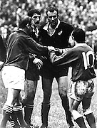 Referee Alan Hosie has ordered Graeme Higginson off. Phil Bennett intervenes. Graham Mourie in middle. All Blacks v Wales, 1 November 1980. Photo: PHOTOSPORT/Peter Bush