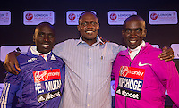 Virgin Money London Marathon 2015<br /> <br /> At a press conference featuring some of the the leading contenders for the London Marathon.<br /> Two of the top contenders pose with their coach.<br /> <br /> Left to right<br /> Emmanuel Mutai  Kenya<br /> Patrick Sang  (coach) Kenya<br /> Eliud Kipchoge  Kenya<br /> <br /> <br /> <br /> <br /> <br /> Photo: Bob Martin for Virgin Money London Marathon<br /> <br /> This photograph is supplied free to use by London Marathon/Virgin Money.