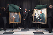 Ohio University President Roderick McDavis and his wife, Deborah McDavis, remove the coverings from their portraits at an unveiling ceremony held at the newly renovated McCracken Hall on February 9, 2017.