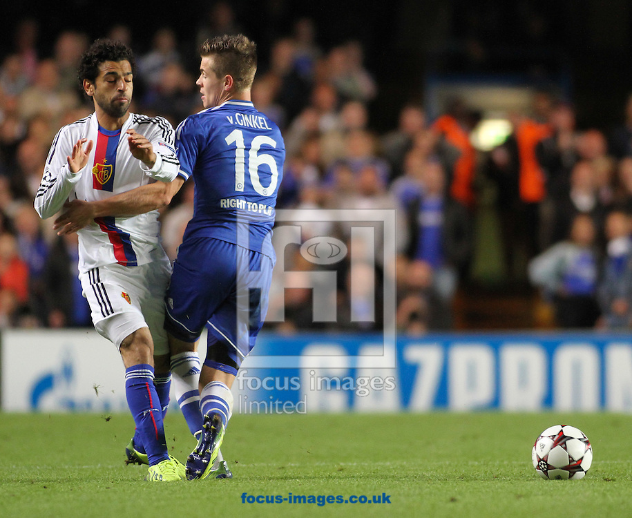 Picture by David Horn/Focus Images Ltd +44 7545 970036<br /> 18/09/2013<br /> Marco van Ginkel of Chelsea holds off Mohamed Salah of FC Basel during the UEFA Champions League match at Stamford Bridge, London.