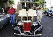 LANGHORNE, PA - JUNE 21:  Erwin Pietsch (L) and his wife Nancy Pietsch look at a 1953 MG during the Langhorne Classic Car Show June 21, 2014 in Langhorne, Pennsylvania.   Teams of cancer survivors and other participants walked around the school's track to raise money for cancer research. About 200 cars were on display at the 8th Annual event. (Photo by William Thomas Cain/Cain Images)