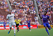 New England Revolution forward Teal Bunbury (10) and FC Cincinnati defender Alvas Powell (92) chase down the ball during a MLS soccer game, Sunday, July 21, 2019, in Cincinnati, OH. The Revolution defeated FC Cincinnati 2-0.(Jason Whitman/Image of Sport)