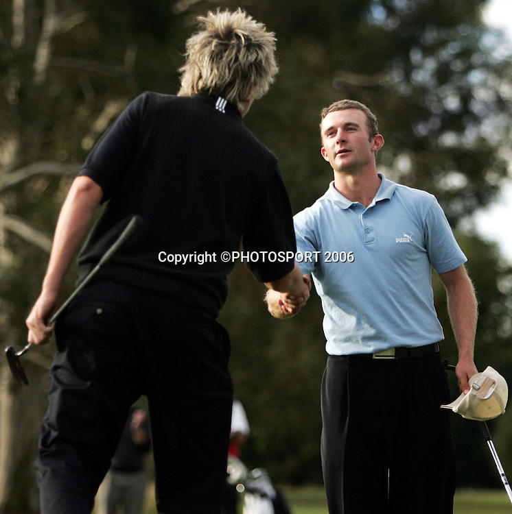 Shandon's Andrew Green shakes hands with Australia's Mitchell Brown after beating him in the 2006 New Zealand Mens Golf Amateur Championship final at Coringa Golf Course, Christchurch, on Sunday 9 April 2006. Photo: Tim Hales/PHOTOSPORT