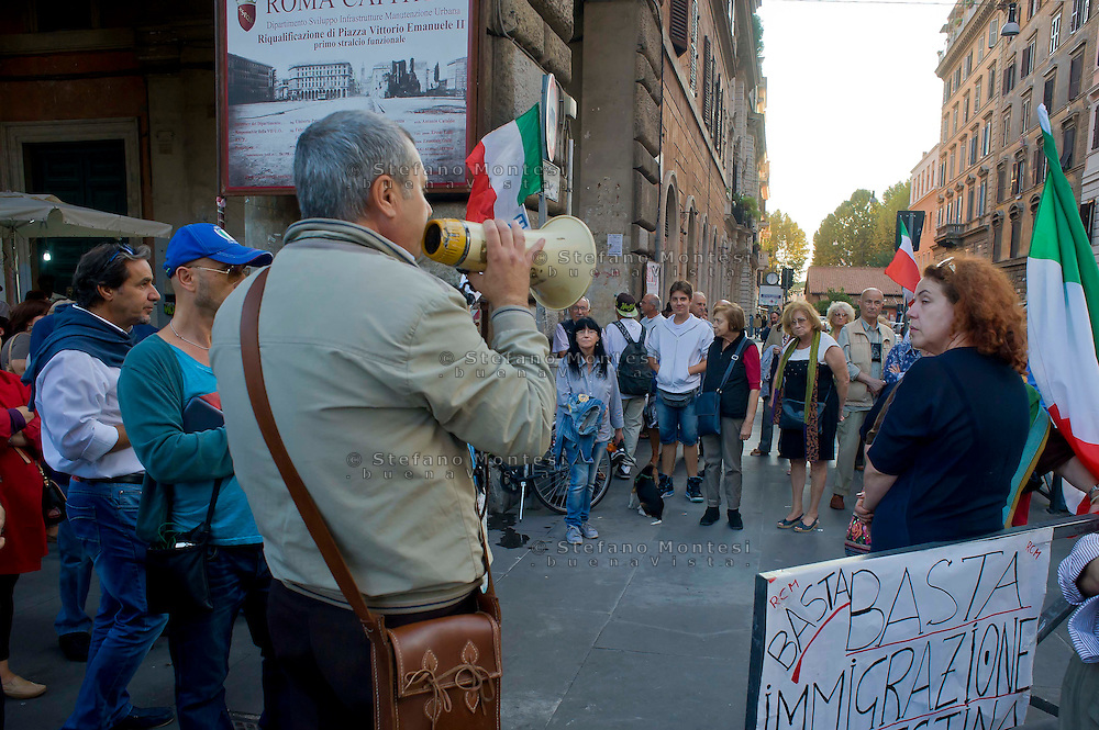 Roma 8 Ottobre 2014<br /> Manifestazione contro l'immigrazione clandestina, il degrado, l'illegalit&agrave; a Piazza Vittorio, organizzata dal Comitato Difesa Roma Caput Mundi.<br /> Rome October 8, 2014<br /> Demonstration against illegal immigration, degradation, illegal to Piazza Vittorio, organized by the Committee for the Defense  Roma Caput Mundi.