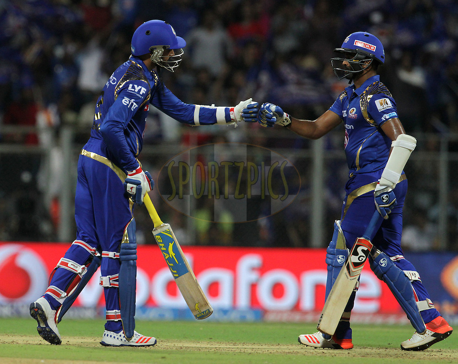 Mumbai Indians player Harbhajan Singh and Mumbai Indians player Vinay Kumar during match 1 of the Vivo Indian Premier League ( IPL ) 2016 between the Mumbai Indians and the Rising Pune Supergiants held at the Wankhede Stadium in Mumbai on the 9th April 2016<br /> <br /> Photo by Vipin Pawar/ IPL/ SPORTZPICS