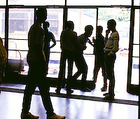 Youth in inner city secondary school causing disruption in hallway.
