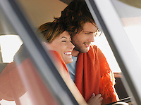 Couple embracing in front seat of van close up