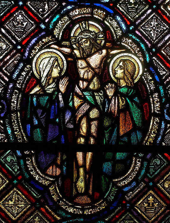 stained glass of Jesus on the cross flanked by women of Jerusalem, inside chapel at St. Joan of Arc Church, Nashotah, Wis. (Photo by Sam Lucero)
