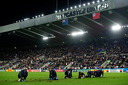 Groundsmen do their best to repair the cut up St James' Park pitch at half time - Mandatory byline: Patrick Khachfe/JMP - 07966 386802 - 09/10/2015 - RUGBY UNION - St James' Park - Newcastle, England - New Zealand v Tonga - Rugby World Cup 2015 Pool C.