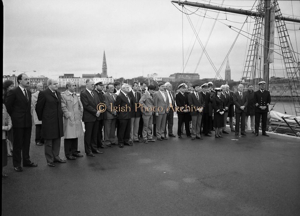 Asgard II departs for Australia.   (R66)..1987..15.10.1987..10.15.1987..15th October 1987..The Asgard II training ship departed from the National Yacht Club in Dun Laoghaire en route to Australia. The Asgard II was a purpose built training brigantine built by Jack Tyrrell in Wicklow. On hand to sent the Asgard Ii on her way was An Taoiseach, Mr Charles Haughey, and Mr Frank Milne the Australian Ambassador to Ireland...A view of the dignitaries and crew members listening to the speech being given by An Taoiseach, Charles Haughey TD.