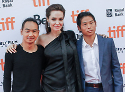 """Angelina Jolie and her sons Maddox (left) and Pax attend the """"First They Killed My Father"""" Premiere during the 2017 Toronto International Film Festival at the Princess of Wales Theatre, in Toronto, Canada, on September 11 2017."""