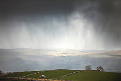 © Licensed to London News Pictures. 25/04/2017. Kirkby Stephen UK. Heavy storm clouds roll in over Kirby Stephen in Cumbria today as snow is expected later on higher ground. Photo credit: Andrew McCaren/LNP