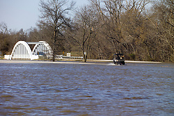 Bush Creek Marsh Arch Rainbow Bridge on Old Route 66 Riverton, KS. Flooded by a 100 Year Flood on 20 March 2008. View of roadway underwater, approx view southwest, north of the bridge. John North, local resident and bridge keeper, on Gator with his Lab checking out the scene.