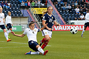 Elvira Urazaeva (#8) of Belarus slides in to clear the ball away from Erin Cuthbert (#22) of Scotland during the FIFA Women's World Cup UEFA Qualifier match between Scotland Women and Belarus Women at Falkirk Stadium, Falkirk, Scotland on 7 June 2018. Picture by Craig Doyle.