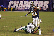 SAN DIEGO, CA - JANUARY 8:  Running back LaDainian Tomlinson #21 (rushed for 80 yards on 26 carries) of the San Diego Chargers tries to avoid a sideline tackle by cornerback Derrick Strait #21 of the New York Jets at Qualcomm Stadium on January 8, 2005 in San Diego, California. The Jets defeated the Chargers 20-17 in overtime in the AFC Wild Card Game. ©Paul Anthony Spinelli  *** Local Caption *** LaDainian Tomlinson; Derrick Strait