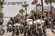 Bikers cruise down Main Street during the 74th Annual Daytona Bike Week March 7, 2015 in Daytona Beach, Florida.