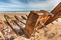 A very old shipwreck using wooden pegs instead of metal rods to hold the planking to the beams.