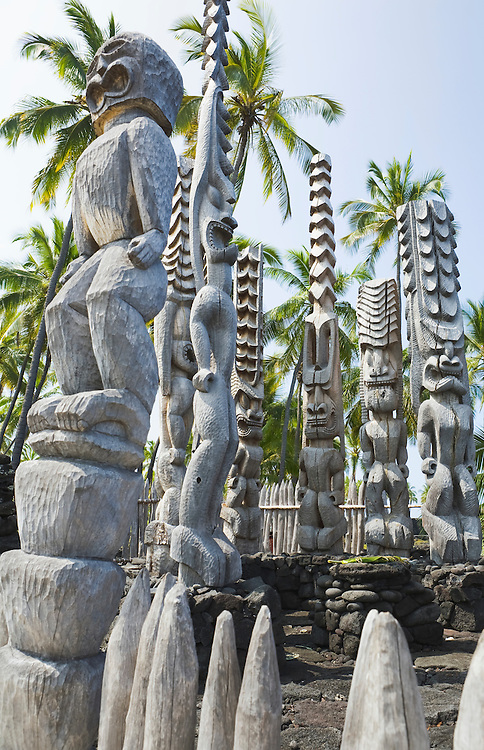 A grouping of Ki'i (wooden images) at  Pu'uhonua o Honaunau National Historical Park on Hawaii (The Big Island) watch over the Hale o Keawe, a temple and mosoleum