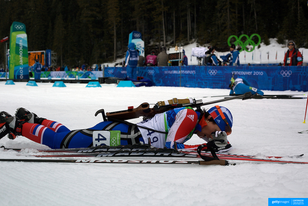 Winter Olympics, Vancouver, 2010. Olga Medvedtseva, (left),  Russian Federation, feels the pain at the endhe Women's 7.5 KM Sprint Biathlon at The Whistler Olympic Park, Whistler, during the Vancouver  Winter Olympics. 13th February 2010. Photo Tim Clayton